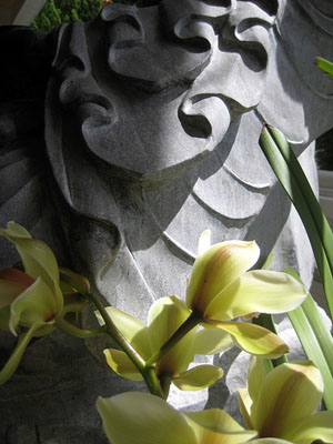 Carved stone fabric and orchids