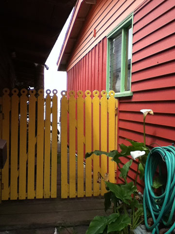 Red house yellow fence