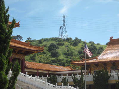 Temple roofs and hills with flag